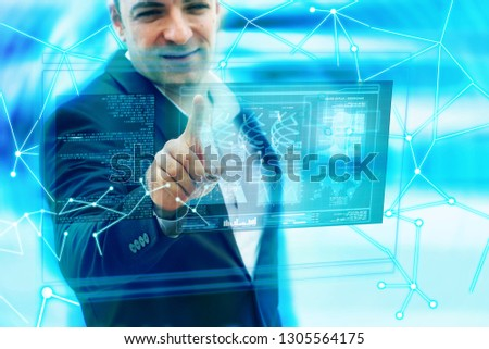 Futuristic man touch hologram screen  #1305564175