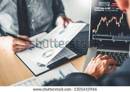 Business Team Investment Entrepreneur Trading discussing and analysis graph stock market trading,stock chart concept #1305610966