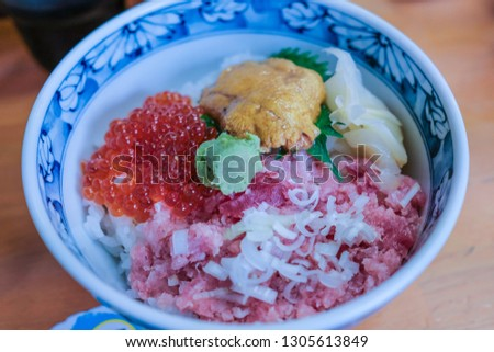 Bowl of rice topped with sashimi. Japanese food. #1305613849