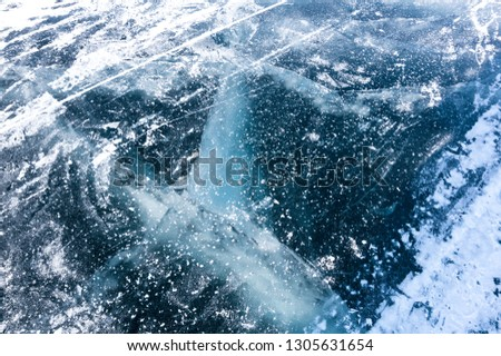 Ice of Lake Baikal, the deepest and largest freshwater lake by volume in the world, located in southern Siberia, Russia #1305631654
