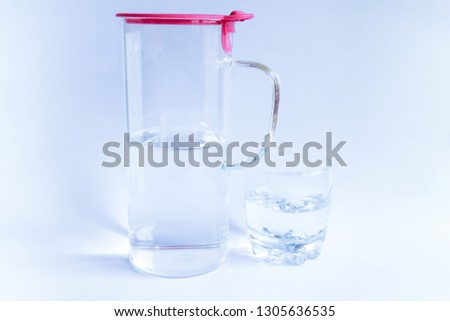 Glass of pure water and bottle on white table. Water Concept                               #1305636535