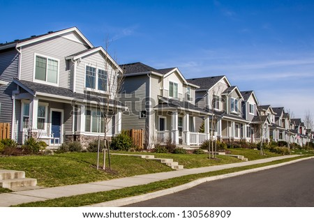 A row of new townhouses or condominiums. #130568909