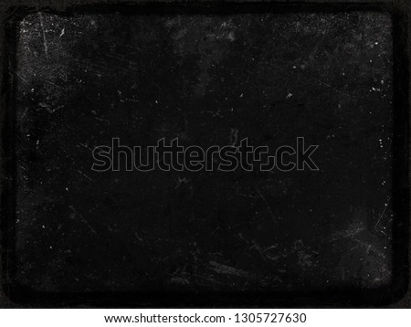 Black grunge scratched texture with frame, old film effect, perfect background for halloween concept, space for your text or picture #1305727630
