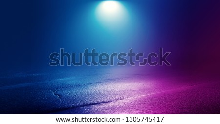 Background of empty room with concrete pavement. Blue and pink neon light. Smoke, fog, wet asphalt with reflection of lights