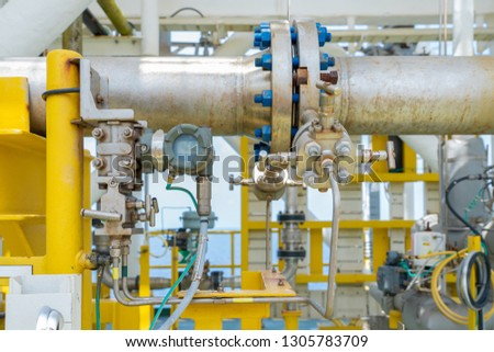 Differential pressure transmitter meter with orifice plate for measure oil flowing inside pipeline by different pressure method and convert from analog to digital data for digital meter. Royalty-Free Stock Photo #1305783709