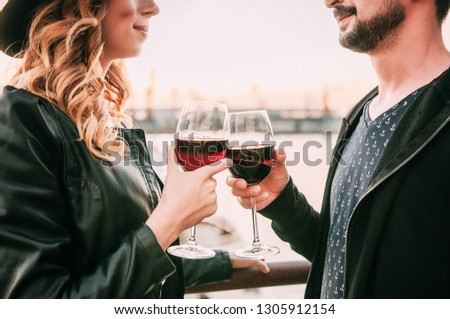 Honeymoon concept, Man and Woman in love, Couple enjoying glass of champagne on tropical beach at sunset, Beautiful sunset light #1305912154
