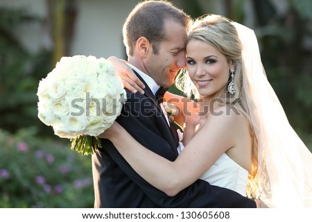 Happy bride and groom on their wedding Royalty-Free Stock Photo #130605608