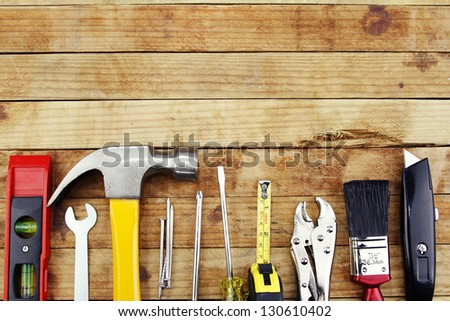 Closeup of assorted work tools on wood #130610402