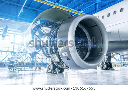 Industrial theme view. Repair and maintenance of aircraft engine on the wing of the aircraft #1306167553