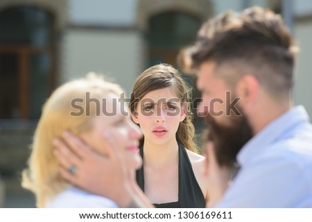 Full of jealousy. Romantic couple of man and woman dating. Jealous girl look at couple in love on street. Bearded man cheating his woman with another girlfriend. Unhappy woman feeling jealous. #1306169611