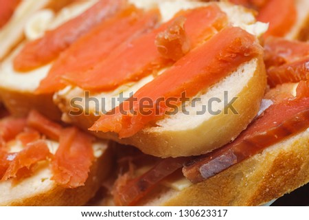 salted red pieces of fish on a bread. delicacy kosher food #130623317