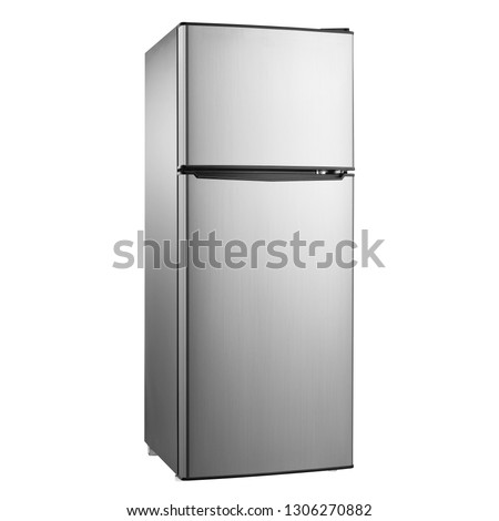 Top Mount Fridge Isolated on White Background. Side View of Stainless Steel Double Door Refrigerator. Modern Kitchen and Household Domestic Appliances. Full Frost Free Freezer #1306270882