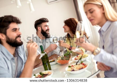 Leisure, eating, food and drinks, people and holidays concept-smiling friends having lunch and drinking wine at home. #1306314838