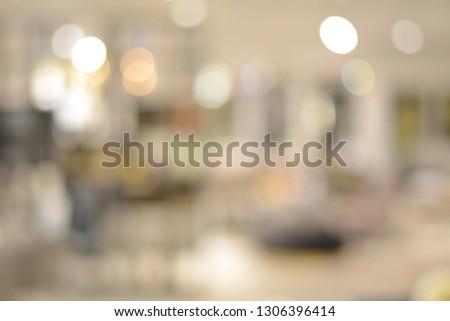 Blurred image of living room with light bokeh for background,use for backdrop or web design,interior design. #1306396414
