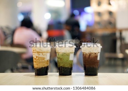 Set of summer drinks, Glass of fresh milk tea, matcha green tea latte and iced dark chocolate, served with black sugar syrup and hot black pearl (Boba) topped with cream cheese, Taiwanese style.  #1306484086