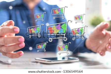 Smartphone with shopping concept between hands of a woman in background #1306549564