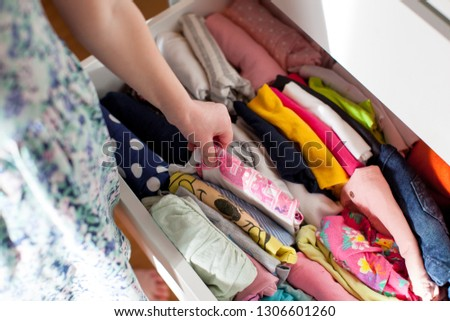 Vertical storage of clothing. Clothing folded for vertical storage in the linen drawer. #1306601260
