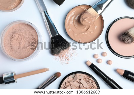 Flat lay composition with skin foundation, powder and beauty accessories on white background #1306612609