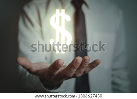 Man hand holding dollar sign. #1306627450