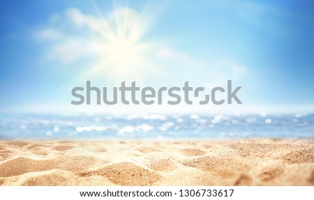 Summer background, nature of tropical golden beach with rays of sun light. Golden sand beach, sea water against blue sky with white clouds. Copy space, summer vacation concept. #1306733617