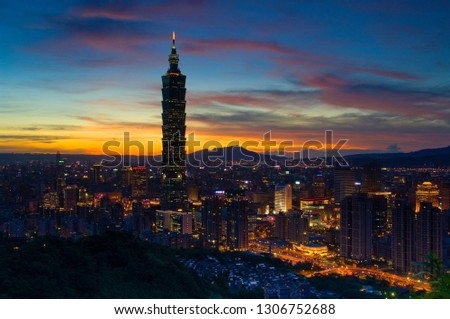 Taipei, Taiwan - August 6, 2008: Sunset moments, golden clouds and blue skies, brilliant lights of urban architecture. #1306752688