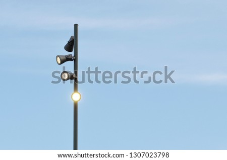 Lamppost with blue sky background #1307023798