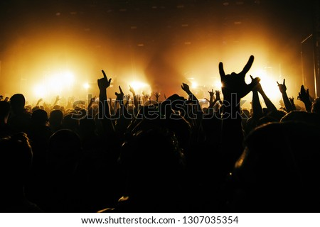 Rock band's concert. Sing of the horns. Yellow spotlight #1307035354