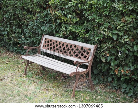 Outdoors bench in a garden build with iron and wood right view #1307069485