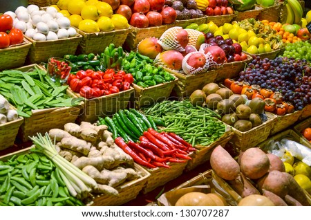 Fruit market with various colorful fresh fruits and vegetables #130707287