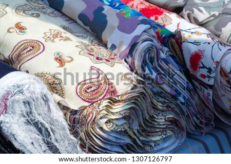 Texture background, pattern. Fabric in rolls #1307126797