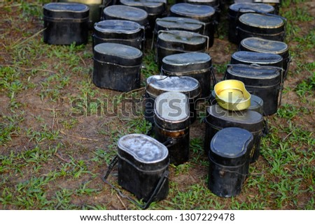 pot for camping,Black pot and golden food plate for soldiers in field training. #1307229478