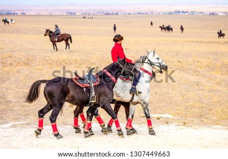 Shymkent, Kazakhstan, November 5, 2018. Nomad riders train on horseback in the steppes of Kazakhstan. Kazakh traditions. Folk entertainment. Kazakh national game Kokpar.  #1307449663