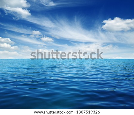 Blue sea water surface on sky #1307519326