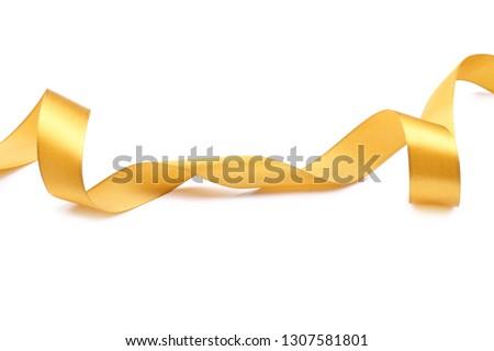 Beautiful golden ribbon on white background #1307581801