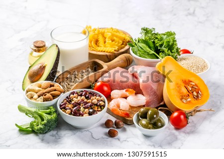 Mediterranean diet concept - meat, fish, fruits and vegetables on bright green background #1307591515