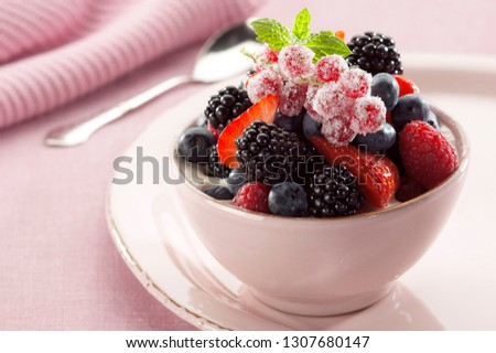 Dessert cream with strawberry, blackberry, blueberry, lemon balm and currant fruit with sugar #1307680147
