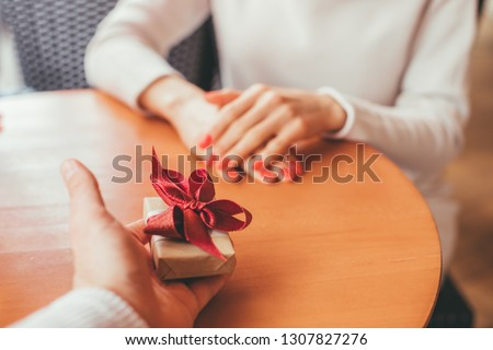 Man gives a present to his girlfriend - POV Image - follow me concept