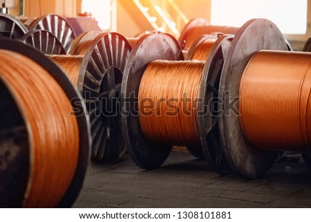 Production of copper wire, bronze cable in reels at factory. #1308101881