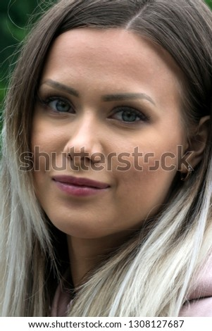 Portrait of beautiful young girl with green eyes and light smile #1308127687