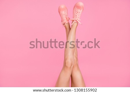 Cropped image view photo of nice cool girlish feminine fit thin slim adorable clean clear shaven teenage legs cozy comfort zone footgear cool lifestyle isolated over pink pastel background #1308155902