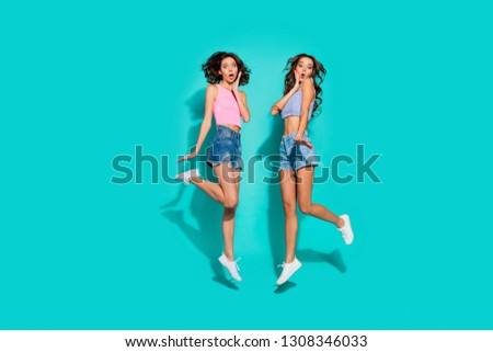 Full length body size side profile photo jumping beautiful funky wavy she her ladies hands arms cheeks unexpected news wearing pink blue jeans denim shorts tank tops isolated teal vivid background #1308346033