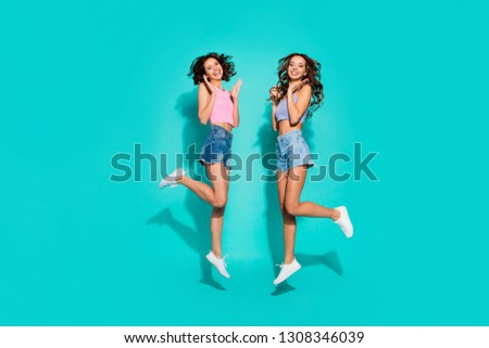 Full length body size side profile photo jumping beautiful funky wavy she her ladies hands arms raised great fortune wearing shiny jeans denim shorts tank tops isolated teal bright vivid background #1308346039