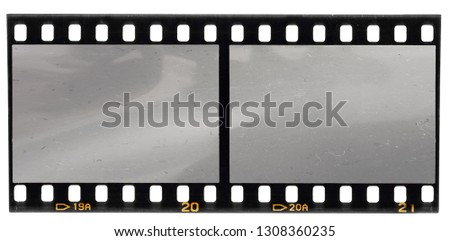 real scan of 35mm film strip or film material isolated on white background, just blend in your own content to make it look old and vintage #1308360235