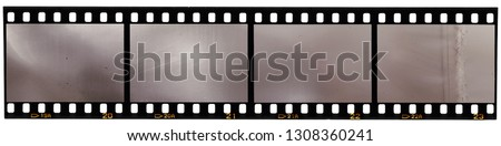 real scan of 35mm film strip or film material isolated on white background, just blend in your own content to make it look old and vintage #1308360241