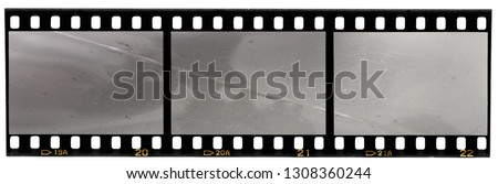 real scan of 35mm film strip or film material isolated on white background, just blend in your own content to make it look old and vintage #1308360244