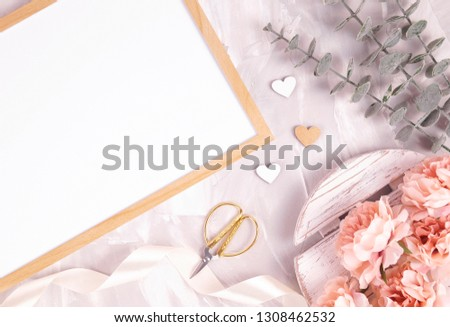Horizontal frame with white paper mockup. Styled stock photo for Social Media, Branding and Blog. Flat lay image with gray background and flowers