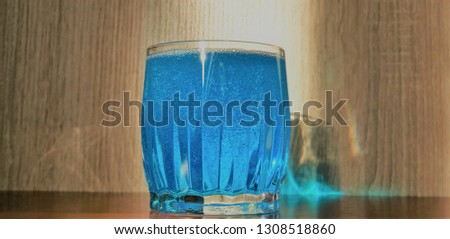 Blue drink. Blue water with bubbles. Blue in a glass.