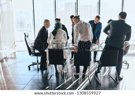 memebrs of meeting taking their sits bfore the conference. employees starting conversation #1308559927