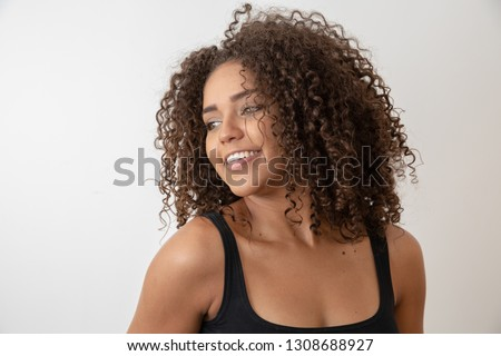 Beauty portrait of african american woman with afro hairstyle and glamour makeup #1308688927
