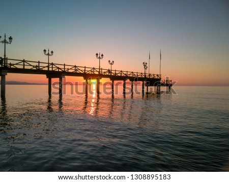 Sunrise through Marbella Beach jetty #1308895183